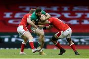 7 February 2021; Robbie Henshaw of Ireland is tackled by Taulupe Faletau of Wales during the Guinness Six Nations Rugby Championship match between Wales and Ireland at the Principality Stadium in Cardiff, Wales. Photo by Gareth Everett/Sportsfile