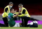 7 February 2021; Jonathan Sexton of Ireland is attended to by team physio Keith Fox, left, and team doctor Dr Ciaran Cosgrave during the Guinness Six Nations Rugby Championship match between Wales and Ireland at the Principality Stadium in Cardiff, Wales. Photo by Gareth Everett/Sportsfile