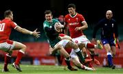 7 February 2021; Billy Burns of Ireland is tackled by Gareth Davies of Wales during the Guinness Six Nations Rugby Championship match between Wales and Ireland at the Principality Stadium in Cardiff, Wales. Photo by Gareth Everett/Sportsfile