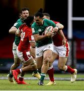 7 February 2021; James Lowe of Ireland is tackled by Josh Navidi and George North of Wales during the Guinness Six Nations Rugby Championship match between Wales and Ireland at the Principality Stadium in Cardiff, Wales. Photo by Gareth Everett/Sportsfile
