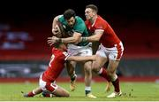 7 February 2021; Robbie Henshaw of Ireland is tackled by Johnny Williams, left, and George North of Wales during the Guinness Six Nations Rugby Championship match between Wales and Ireland at the Principality Stadium in Cardiff, Wales. Photo by Gareth Everett/Sportsfile