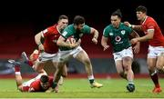 7 February 2021; Robbie Henshaw of Ireland breaks away from the tackles of Johnny Williams, left, and George North of Wales during the Guinness Six Nations Rugby Championship match between Wales and Ireland at the Principality Stadium in Cardiff, Wales. Photo by Gareth Everett/Sportsfile