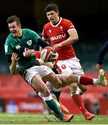 7 February 2021; Billy Burns of Ireland is tackled by Gareth Davies and Louis Rees-Zammit of Wales during the Guinness Six Nations Rugby Championship match between Wales and Ireland at the Principality Stadium in Cardiff, Wales. Photo by Gareth Everett/Sportsfile