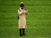 6 February 2021; Katie Harrington, daughter of trainer Jessica Harrington, takes a photo on day 1 of the Dublin Racing Festival at Leopardstown Racecourse in Dublin. Photo by Harry Murphy/Sportsfile