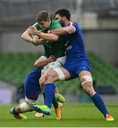 14 February 2021; Garry Ringrose of Ireland is tackled by Grégory Alldritt, left, and Charles Ollivon of France during the Guinness Six Nations Rugby Championship match between Ireland and France at the Aviva Stadium in Dublin. Photo by Ramsey Cardy/Sportsfile