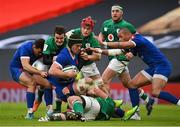 14 February 2021; Grégory Alldritt of France is tackled by Billy Burns and Josh van der Flier of Ireland during the Guinness Six Nations Rugby Championship match between Ireland and France at the Aviva Stadium in Dublin. Photo by Ramsey Cardy/Sportsfile