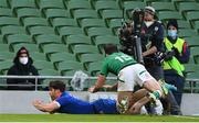 14 February 2021; Damian Penaud of France scores his side's second try despite the tackle of Hugo Keenan of Ireland during the Guinness Six Nations Rugby Championship match between Ireland and France at the Aviva Stadium in Dublin. Photo by Brendan Moran/Sportsfile