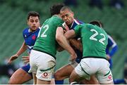 14 February 2021; Gaël Fickou of France is tackled by Robbie Henshaw, 12, and Ross Byrne of Ireland during the Guinness Six Nations Rugby Championship match between Ireland and France at the Aviva Stadium in Dublin. Photo by Brendan Moran/Sportsfile