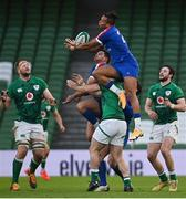 14 February 2021; Teddy Thomas of France gathers possession ahead of James Lowe of Ireland during the Guinness Six Nations Rugby Championship match between Ireland and France at the Aviva Stadium in Dublin. Photo by Ramsey Cardy/Sportsfile