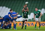 14 February 2021; Antoine Dupont of France kicks ahead of CJ Stander, centre, and Rónan Kelleher of Ireland during the Guinness Six Nations Rugby Championship match between Ireland and France at the Aviva Stadium in Dublin. Photo by Ramsey Cardy/Sportsfile