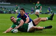 14 February 2021; James Lowe of Ireland touches down in the in-goal area ahead of Antoine Dupont of France during the Guinness Six Nations Rugby Championship match between Ireland and France at the Aviva Stadium in Dublin. Photo by Brendan Moran/Sportsfile