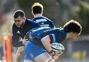 15 February 2021; Alex Soroka is tackled by Ross Molony during Leinster Rugby squad training at UCD in Dublin. Photo by Ramsey Cardy/Sportsfile