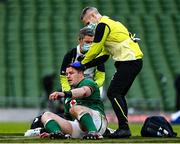 14 February 2021; Cian Healy of Ireland is attended to for a blood injury by team doctor Dr Ciaran Cosgrave during the Guinness Six Nations Rugby Championship match between Ireland and France at the Aviva Stadium in Dublin. Photo by Brendan Moran/Sportsfile
