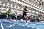 20 February 2021; Leon Reid of Menapians AC, Wexford, right, crosses the line to win the Men's 200m with an indoor personal best of 20.96, ahead of Marcus Lawler of St Laurence O'Toole AC, Carlow, left, who finished second, and Mark Smyth of Raheny Shamrock AC, Dublin, who finished third, during day one of the Irish Life Health Elite Athlete Indoor Micro Meet at Sport Ireland National Indoor Arena at the Sport Ireland Campus in Dublin. Photo by Sam Barnes/Sportsfile
