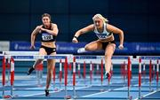 20 February 2021; Sarah Lavin of Emerald AC, Limerick, right, on her way to winning the Women's 60m Hurdles ahead of Kate O'Connor of Dundalk St Gerards AC, Louth, during day one of the Irish Life Health Elite Athlete Indoor Micro Meet at Sport Ireland National Indoor Arena at the Sport Ireland Campus in Dublin. Photo by Sam Barnes/Sportsfile