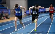 20 February 2021; Mark English of Finn Valley AC, Donegal, centre, dips for the line to win the Men's 800m, ahead of Cian McPhillips of Longford AC,  left, who finished second, during day one of the Irish Life Health Elite Athlete Indoor Micro Meet at Sport Ireland National Indoor Arena at the Sport Ireland Campus in Dublin. Photo by Sam Barnes/Sportsfile