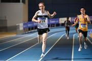 20 February 2021; John Travers of Donore Harriers AC, Dublin, left, celebrates as he crosses the line to win the Men's 3000m, ahead of Darragh McElhinney of UCD AC, right, who finished second, during day one of the Irish Life Health Elite Athlete Indoor Micro Meet at Sport Ireland National Indoor Arena at the Sport Ireland Campus in Dublin. Photo by Sam Barnes/Sportsfile
