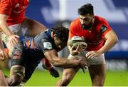20 February 2021; Damian de Allende of Munster is tackled by Bill Mata of Edinburgh during the Guinness PRO14 match between Edinburgh and Munster at BT Murrayfield Stadium in Edinburgh, Scotland. Photo by Paul Devlin/Sportsfile