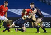 20 February 2021; Andrew Conway of Munster is tackled by Andrew Davidson of Edinburgh during the Guinness PRO14 match between Edinburgh and Munster at BT Murrayfield Stadium in Edinburgh, Scotland. Photo by Paul Devlin/Sportsfile