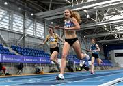 21 February 2021; Georgie Hartigan of Dundrum South Dublin AC, Dublin, crosses the line to win the Women's 800m, ahead of Louise Shanahan of Leevale AC, Cork, left, who finished second, during day two of the Irish Life Health Elite Athlete Indoor Micro Meet at Sport Ireland National Indoor Arena at the Sport Ireland Campus in Dublin. Photo by Sam Barnes/Sportsfile
