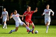 21 February 2021; Alec Byrne of Cork City is tackled by Jamie Lennon of St Patrick's Athletic during the pre-season friendly match between Cork City and St Patrick's Athletic at O'Shea Park in Blarney, Cork. Photo by Eóin Noonan/Sportsfile