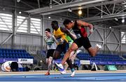 21 February 2021; Leon Reid of Menapians AC, Wexford, right, dips for the line to win the Men's 60m, ahead of Israel Olatunde of UCD AC, Dublin, second from left, who finished second, during day two of the Irish Life Health Elite Athlete Indoor Micro Meet at Sport Ireland National Indoor Arena at the Sport Ireland Campus in Dublin. Photo by Sam Barnes/Sportsfile