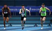 21 February 2021; Dean Adams of Ballymena & Antrim AC, Antrim, centre, competing in the Men's 60m, alongside Leon Reid of Menpians AC, Wexford, left, and Marcus Lawler of St Laurence O'Tooles AC, Carlow, during day two of the Irish Life Health Elite Athlete Indoor Micro Meet at Sport Ireland National Indoor Arena at the Sport Ireland Campus in Dublin. Photo by Sam Barnes/Sportsfile