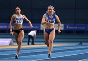 21 February 2021; Molly Scott of St Laurence O'Tooles AC, Carlow, right, on her way to winning the Women's 60m, ahead of Kate Doherty of Dundrum South Dublin AC, who finished third,  during day two of the Irish Life Health Elite Athlete Indoor Micro Meet at Sport Ireland National Indoor Arena at the Sport Ireland Campus in Dublin. Photo by Sam Barnes/Sportsfile