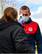 21 February 2021; John Mountney of St Patrick's Athletic has his temperature taken on arrival prior to the pre-season friendly match between Cork City and St Patrick's Athletic at O'Shea Park in Blarney, Cork. Photo by Eóin Noonan/Sportsfile