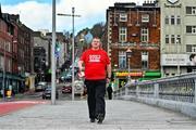 25 February 2021; Special Olympics athlete Denis O'Gorman on St Patrick's Bridge ahead of walking his 100th Marathon around Cork City Centre. Photo by Eóin Noonan/Sportsfile