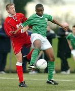 4 February 2004; Emeka Onwubiko, Republic of Ireland U-15, in action against Wales U-15's Scott Evans. U-15 Friendly, Republic of Ireland U-15 v Wales U-15, AUL Complex, Clonshaugh, Dublin. Picture credit; David Maher / SPORTSFILE *EDI*