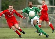 4 February 2004; Emeka Onwubiko, Republic of Ireland U-15, in action against Wales U-15's Chris Gunter. U-15 Friendly, Republic of Ireland U-15 v Wales U-15, AUL Complex, Clonshaugh, Dublin. Picture credit; David Maher / SPORTSFILE *EDI*