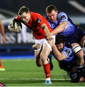 26 February 2021; Nick McCarthy of Munster is tackled by Kirby Myhill and Shane Lewis-Hughes of Cardiff Blues during the Guinness PRO14 match between Cardiff Blues and Munster at Cardiff Arms Park in Cardiff, Wales. Photo by Chris Fairweather/Sportsfile
