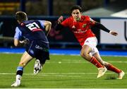 26 February 2021; Joey Carbery of Munster in action against Lewis Jones of Cardiff Blues during the Guinness PRO14 match between Cardiff Blues and Munster at Cardiff Arms Park in Cardiff, Wales. Photo by Gareth Everett/Sportsfile