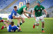 27 February 2021; Jordan Larmour of Ireland offloads to team-mate Will Connors, right, as he is tackled by Juan Ignacio Brex and Luca Sperandio of Italy to set up their side's third try during the Guinness Six Nations Rugby Championship match between Italy and Ireland at Stadio Olimpico in Rome, Italy. Photo by Roberto Bregani/Sportsfile