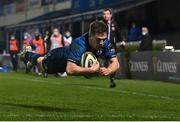 28 February 2021; Luke McGrath of Leinster dives over to score his side's fifth try during the Guinness PRO14 match between Leinster and Glasgow Warriors at the RDS Arena in Dublin. Photo by Ramsey Cardy/Sportsfile