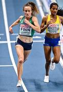 4 March 2021; Michelle Finn of Ireland passes Samrawit Mengsteab of Sweden in their heat of the Women's 3000m during the European Indoor Athletics Championships at Arena Torun in Torun, Poland. Photo by Sam Barnes/Sportsfile