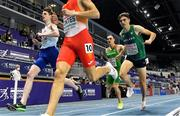4 March 2021; Andrew Coscoran of Ireland finishes third in his heat of the Men's 1500m behind winner Ignacio Fontes of Spain and Piers Copeland of Great Britain and ahead of István Szögi of Hungary during the European Indoor Athletics Championships at Arena Torun in Torun, Poland. Photo by Sam Barnes/Sportsfile