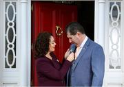 6 March 2021; Mícheál Naughton, Uachtarán, LGFA, is presented with his Presidential medal by his wife, Annette, at the family home in county Donegal. Mícheál Naughton was inaugurated as the new President of the Ladies Gaelic Football Association at 2021 Annual Congress, which was held remotely due to Covid-19 restrictions. Photo by Stephen McCarthy/Sportsfile