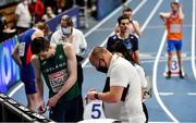 5 March 2021; Mark English of Ireland is assisted by an official as he changes his lane number prior to his heat of the Men's 800m during the second session on day one of the European Indoor Athletics Championships at Arena Torun in Torun, Poland. Photo by Sam Barnes/Sportsfile