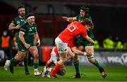 5 March 2021; Ultan Dillane of Connacht is tackled by Fineen Wycherley, left, and Ben Healy of Munster during the Guinness PRO14 match between Munster and Connacht at Thomond Park in Limerick. Photo by Ramsey Cardy/Sportsfile