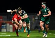 5 March 2021; Matt Healy of Connacht evades the tackle of Ben Healy of Munster during the Guinness PRO14 match between Munster and Connacht at Thomond Park in Limerick. Photo by Ramsey Cardy/Sportsfile