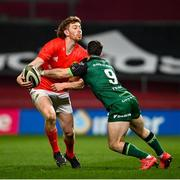 5 March 2021; Ben Healy of Munster is tackled by Caolin Blade of Connacht during the Guinness PRO14 match between Munster and Connacht at Thomond Park in Limerick. Photo by Ramsey Cardy/Sportsfile