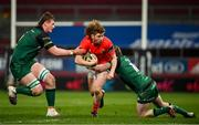 5 March 2021; Ben Healy of Munster is tackled by Gavin Thornbury, left, and Jack Carty of Connacht during the Guinness PRO14 match between Munster and Connacht at Thomond Park in Limerick. Photo by Ramsey Cardy/Sportsfile