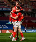 5 March 2021; Mike Haley, left, celebrates with Munster team-mates Craig Casey and Jack O'Donoghue after scoring his side's second try during the Guinness PRO14 match between Munster and Connacht at Thomond Park in Limerick. Photo by Ramsey Cardy/Sportsfile