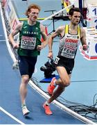 6 March 2021; Séan Tobin of Ireland and Marcel Fehr of Germany compete in the Men's 3000m heats during the first session on day two of the European Indoor Athletics Championships at Arena Torun in Torun, Poland. Photo by Sam Barnes/Sportsfile