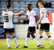 6 March 2021; Val Adedokun, centre, is congratulated by Dundalk team-mates Ryan O'Kane, left, and David McMillan after scoring their second goal during the Jim Malone Cup match between Drogheda United and Dundalk at Head In The Game Park in Drogheda, Louth. Photo by Stephen McCarthy/Sportsfile
