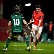 5 March 2021; Shane Daly of Munster kicks past Jack Carty of Connacht during the Guinness PRO14 match between Munster and Connacht at Thomond Park in Limerick. Photo by Ramsey Cardy/Sportsfile