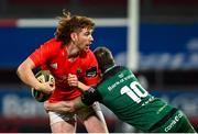 5 March 2021; Ben Healy of Munster is tackled by Jack Carty of Connacht during the Guinness PRO14 match between Munster and Connacht at Thomond Park in Limerick. Photo by Ramsey Cardy/Sportsfile