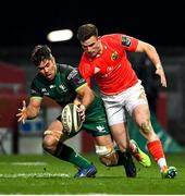 5 March 2021; Shane Daly of Munster in action against Jarrad Butler of Connacht during the Guinness PRO14 match between Munster and Connacht at Thomond Park in Limerick. Photo by Ramsey Cardy/Sportsfile
